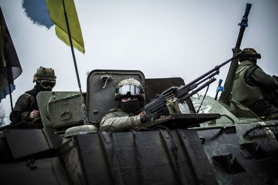 Ukrainian soldiers are seen in an armored vehicle near the city of Artemivsk, in the Donetsk region. Photo: MANU BRABO / AFP / Getty Images / Manu Brabo