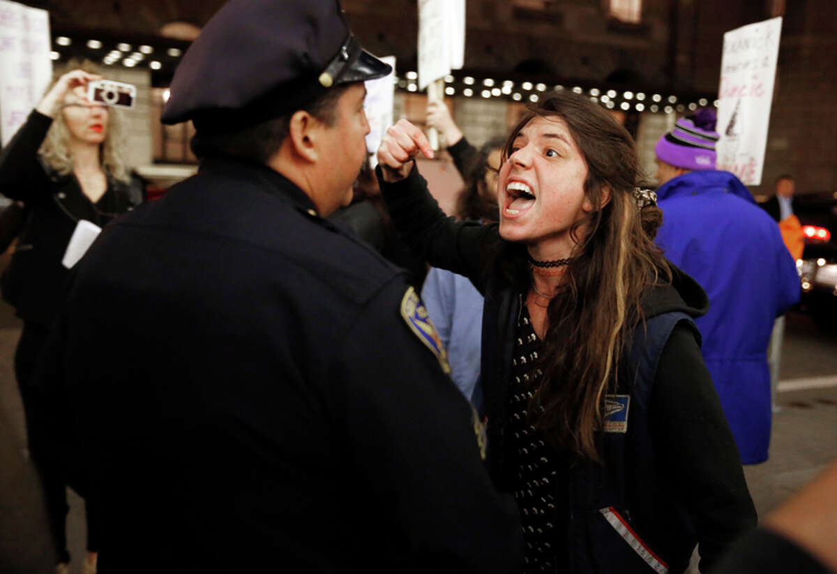 Protester Lena Seagrabe yells at San Francisco police Officer Jesus Pena outside the Crunchies.