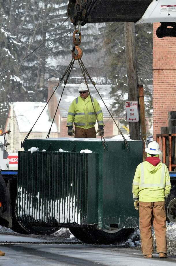 Workers from National Grid remove a transformer from the grounds of Ellis Hospital Friday morning Feb. 6, 2015, in Schenectady, N.Y.      (Skip Dickstein/Times Union) Photo: SKIP DICKSTEIN / 00030507A