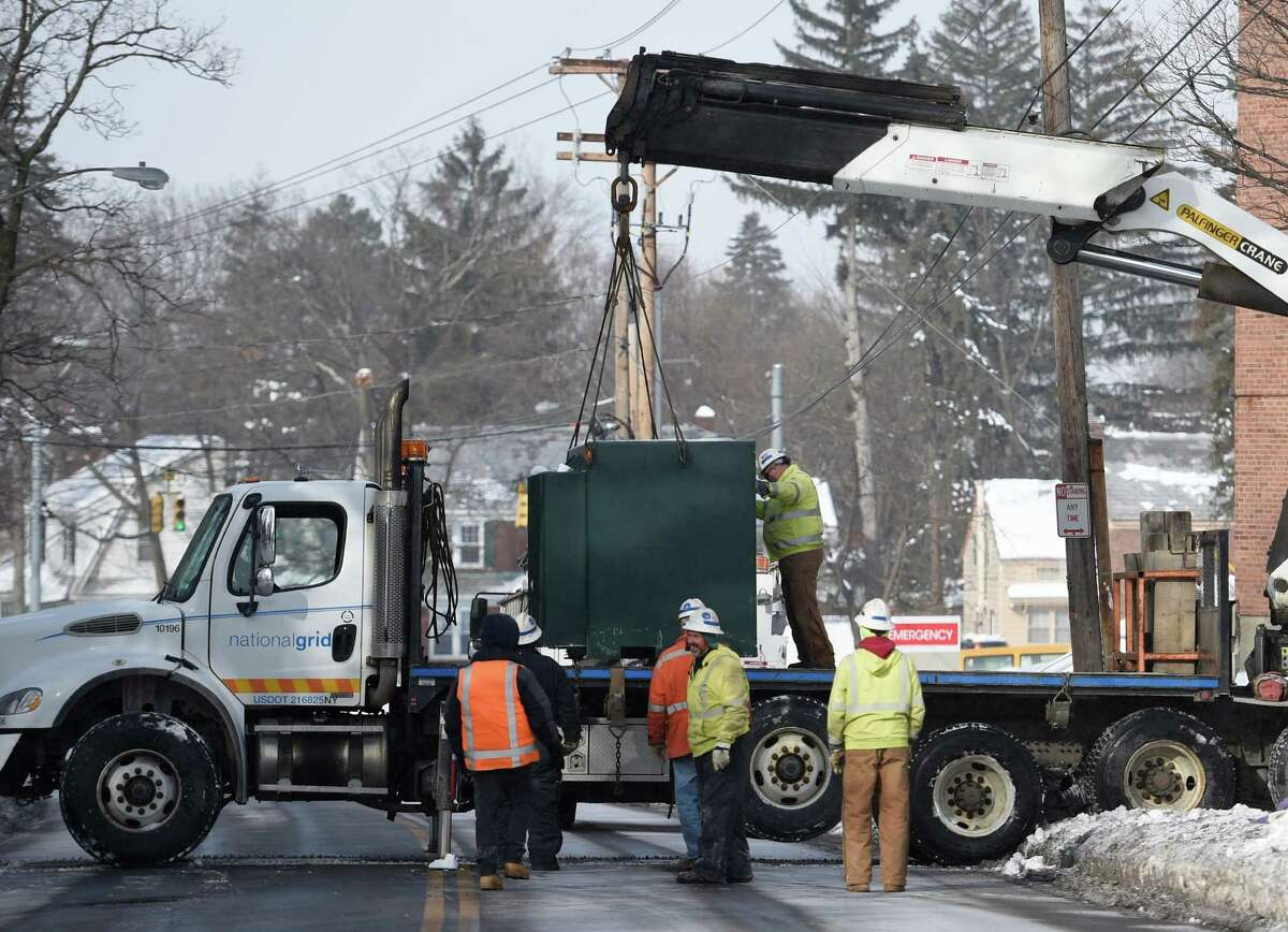 Workers from National Grid remove a transformer from the grounds of Ellis Hospital Friday morning Feb. 6, 2015, in Schenectady, N.Y. (Skip Dickstein/Times Union)