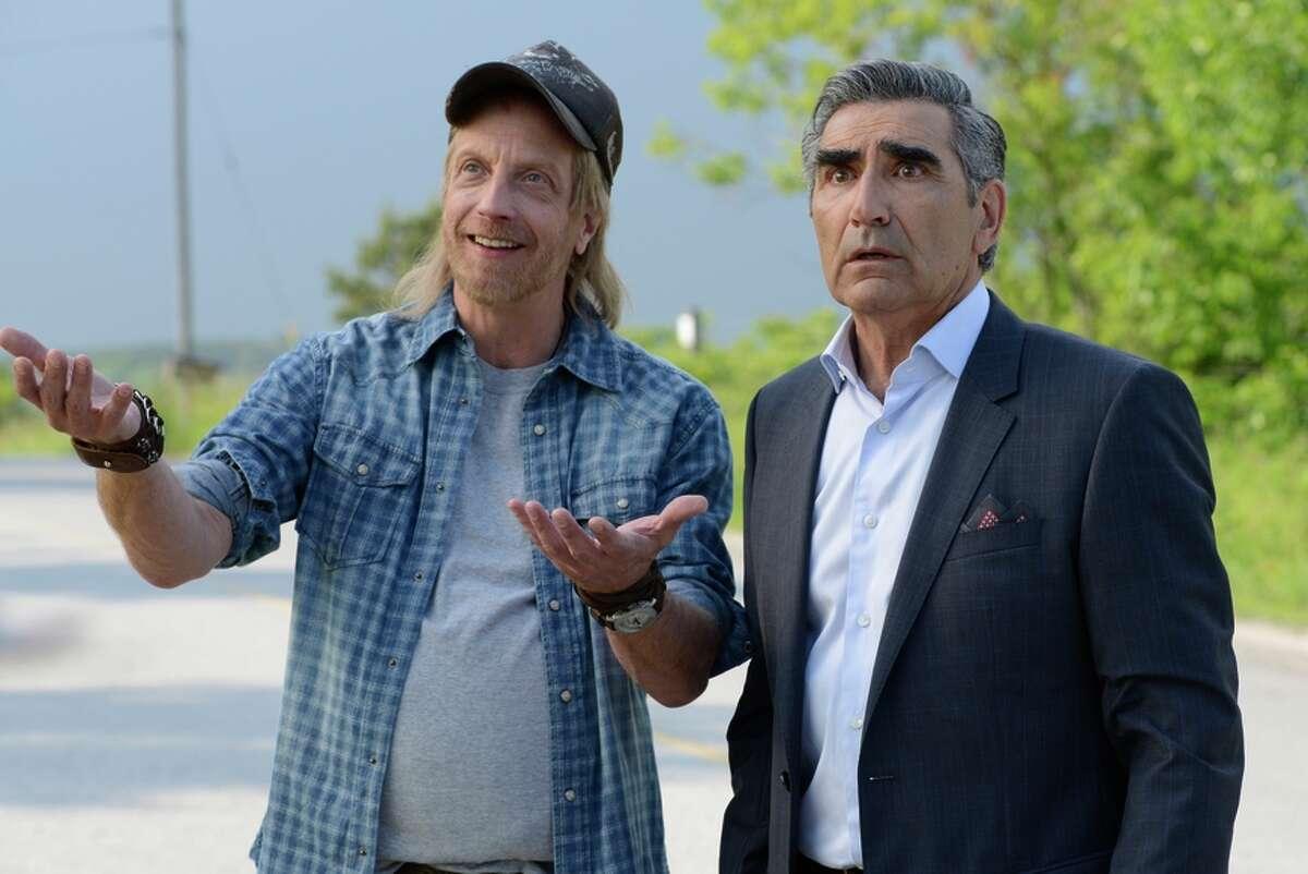 "Chris Elliott (left) plays Roland Schitt in sitcom ""Schitt's Creek,"" starring and co-created by Eugene Levy (right)."
