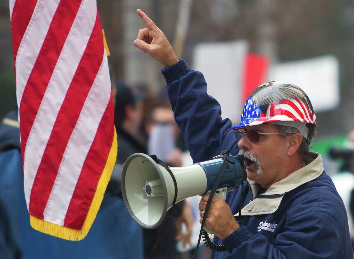 Jeff Lewis leads a union protest downtown this month.