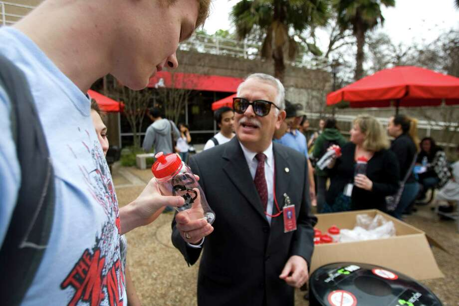 University of Houston student Houston Boyer, of Dickinson, receives a water bottle from Carl Carlucci during a rally to kick off UH's RecycleMania event on campus  Wednesday, Jan. 20, 2010, Houston. RecycleMania is a friendly competition between colleges and universities nationwide which encourages green initiatives through measured recycling and events which promote sustainability. The contest runs through March 27. ( Brett Coomer / Chronicle ) Photo: Brett Coomer, Staff / Houston Chronicle