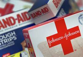 FILE - This Oct. 16 2012, file photo, shows Johnson and Johnson products, including Band Aid brand adhesive bandages, arranged for a photo in St. Petersburg, Fla. Johnson & Johnson reports qurterly financial results on Tuesday, July 15, 2014. (AP Photo/Chris O'Meara, File)