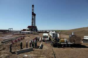 Norway's Statoil, which has extensive U.S. operations including this drilling site in North Dakota's Bakken Shale, said it will cut U.S.  onshore capital spending by 25 percent. ( Jay Pickthorn/AP/Statoil).