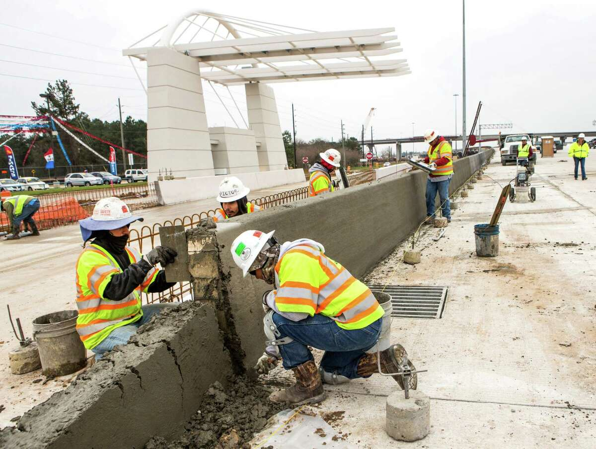Workers continued progress Friday on the Tomball Tollway, a project long awaited by commuters in northwest Harris County.