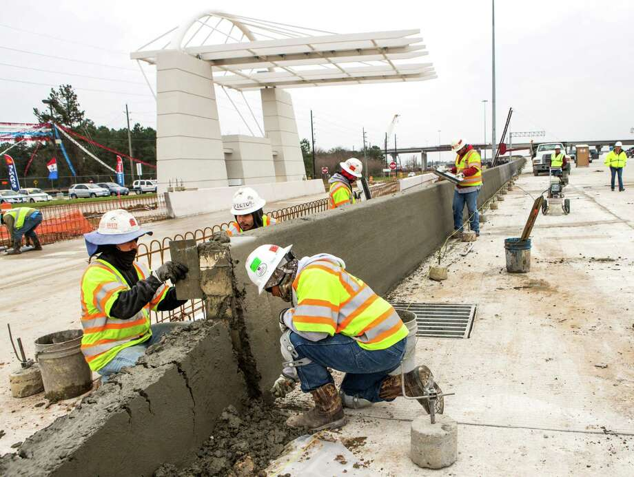 Workers put the finishing touches on the Tomball Tollway in February. The tollway's first phase opened in April. Photo: Brett Coomer, Staff / © 2015 Houston Chronicle