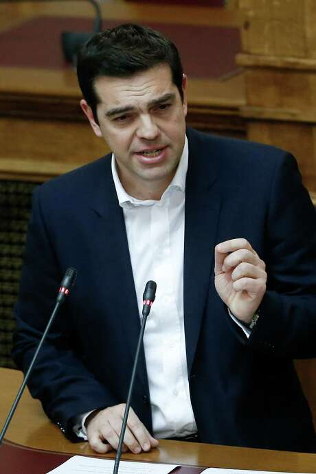 Greece's Prime Minister Alexis Tsipras and leader of the Syriza left-wing party addresses his party members of parliament in Athens, Thursday, Feb. 5, 2015.  Greece's new finance minister failed to convince his skeptical German counterpart to immediately back a new approach on Greece's debt as the two met for the first time since the anti-bailout Syriza swept to power in Athens. (AP Photo/Petros Giannakouris ) Photo: Petros Giannakouris, STF / AP