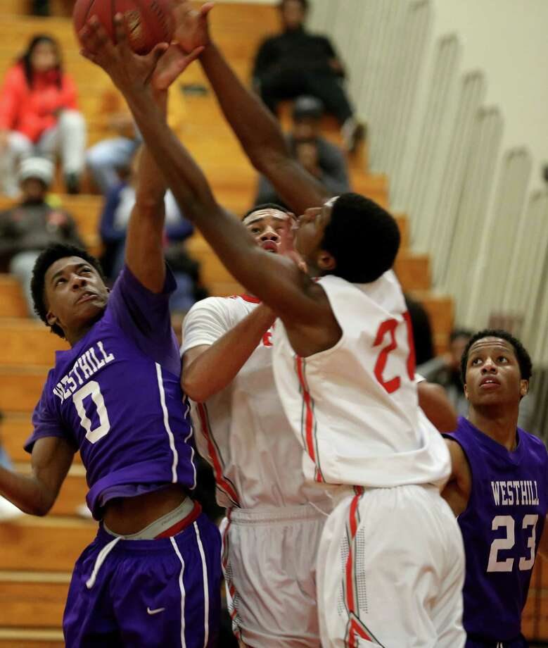 Westhill's # 0 Parish Rowell battles for a rebound against Bridgeport Central's #21 Joaquim Johnson and #11 Marcus Blackwell during Friday evening match-up at Central. Westhill would win 69-68. Photo: Mike Ross / Mike Ross Connecticut Post freelance -www.mikerossphoto.com