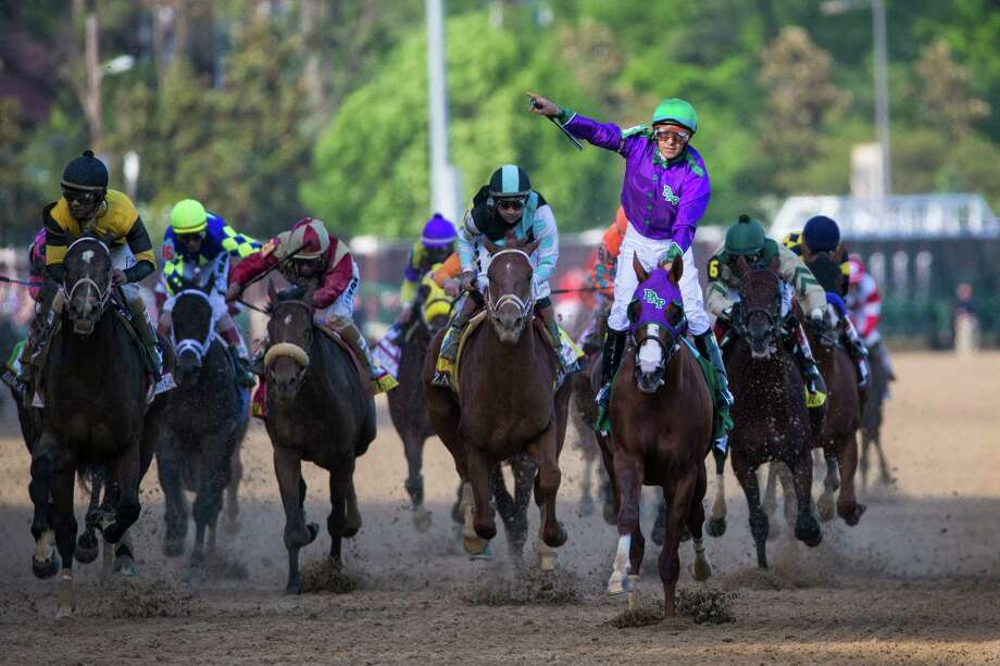 California Chrome, ridden by Victor Espinoza, wins the 140th Kentucky Derby at Churchill Downs in Louisville, Ky., in May 2014. He'll run at Santa Anita this weekend. Photo: JABIN BOTSFORD / New York Times / NYTNS