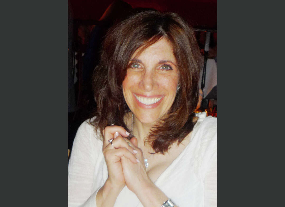 This photo provided by the Brody family shows an undated photo of Ellen Brody who was killed in the SUV that was hit by a Metro-North commuter train in Vahalla, N.Y, Tuesday Feb. 3, 2015. The National Transportation Safety Board is looking into how familiar the SUV driver was with her car and her route, whether she was using a cellphone and whether the backed-up traffic played a role. (AP Photo/Family photo via Jeff Schaeffer) ORG XMIT: NY120