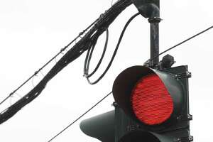 Traffic lights hang at the intersection of Northern Boulevard and Shaker Road, the site of a future red light camera, Friday afternoon, May 9, 2014, in Albany, N.Y. (Will Waldron/Times Union)