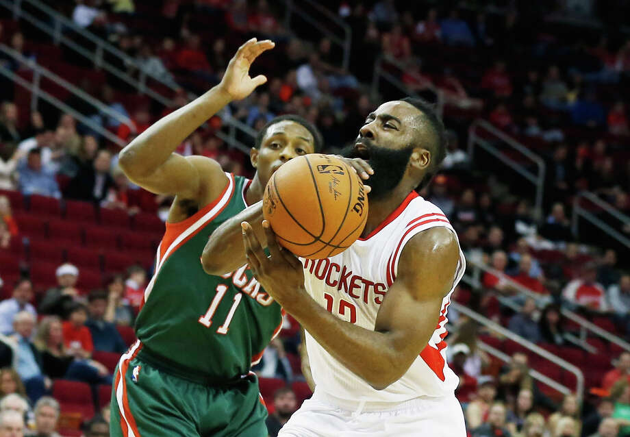 Rockets guard James Harden (13) loses control of the ball as he goes up for a shot against the Bucks' Brandon Knight in Friday night's game at Toyota Center. Harden added to his MVP-like credentials, getting 33 points, five assists and three rebounds in the Rockets' 117-111 victory. Photo: Scott Halleran, Staff / 2015 Getty Images