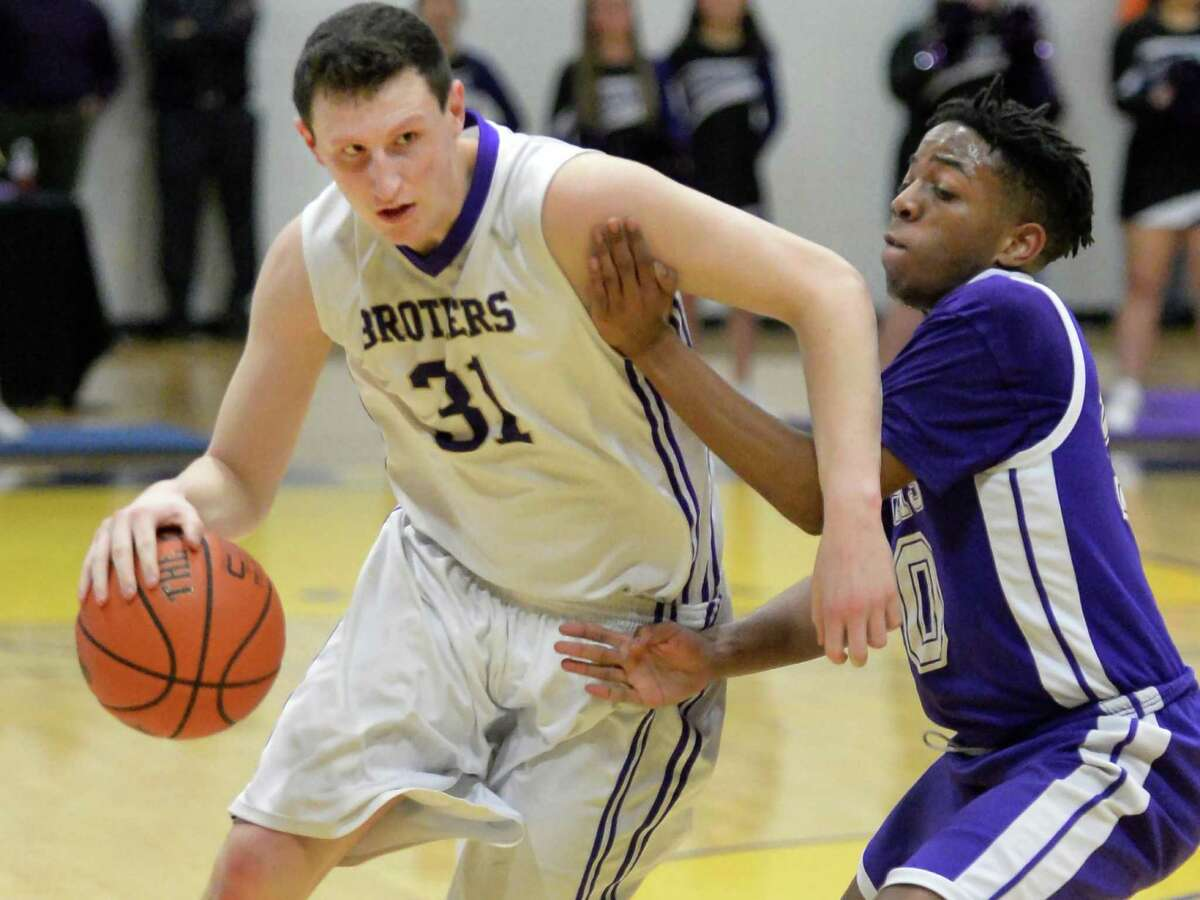 CBA's #31 Ian Schultz, left, and CCHS's #10 Terrance Jones during Friday's game at CBA Feb. 6, 2015, in Colonie, NY. (John Carl D'Annibale / Times Union)