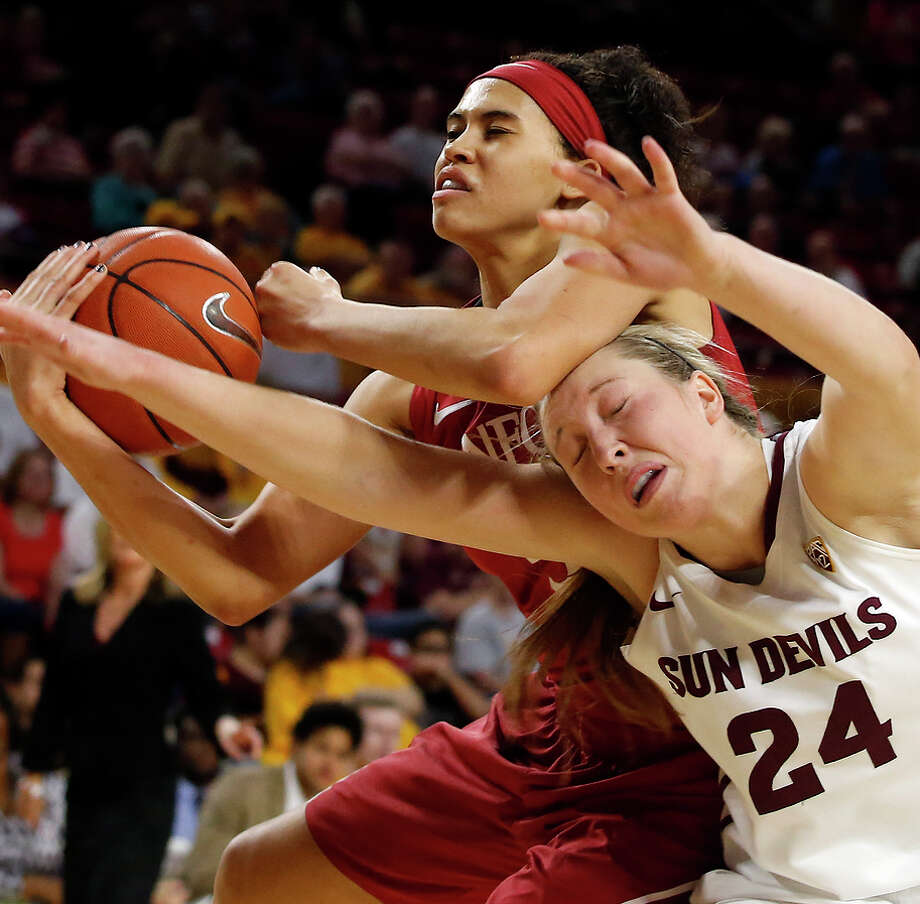 Stanford forward Kaylee Johnson and Arizona State forward Kelsey Moos (24) battle for the ball during the first half. Photo: Rick Scuteri / Associated Press / FR157181 AP