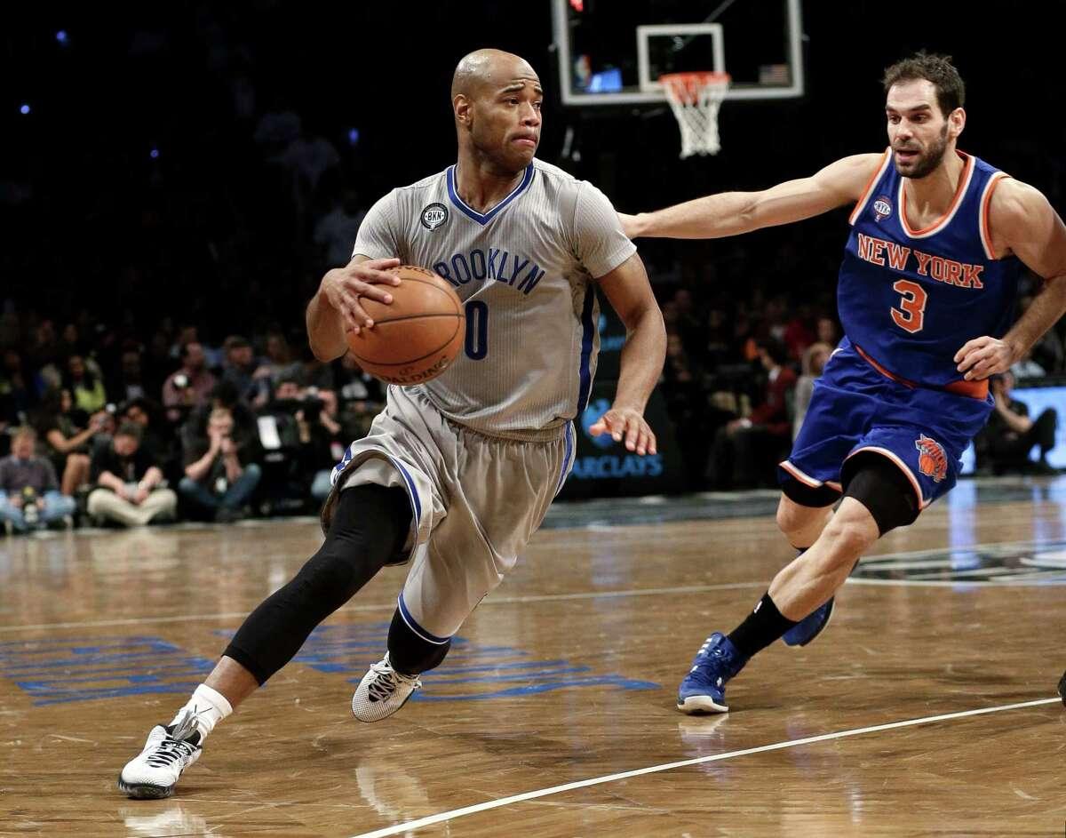 Brooklyn Nets' Jarrett Jack (0) drives past New York Knicks' Jose Calderon (3) during the second half of an NBA basketball game Friday, Feb. 6, 2015, in New York. The Nets won 92-88. (AP Photo/Frank Franklin II) ORG XMIT: NYFF112
