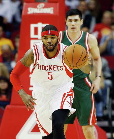 Forward Josh Smith (5) stepped up big for the Rockets against Ersan Ilyasova and the Bucks on Friday night, just missing a triple-double with 14 points, 10 rebounds and eight assists. Photo: Scott Halleran, Staff / 2015 Getty Images