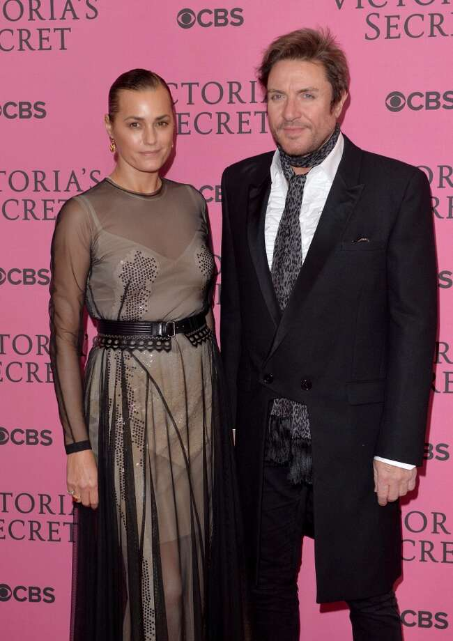 Duran Duran frontman Simon LeBon broke the hearts of girls everywhere when he married model Yasmin Parvaneh in 1985. Three daughters and many years later, the couple is still going strong. Photo: Anthony Harvey, Getty Images For Victoria's Secr