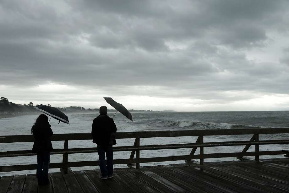 Visitors look out onto the Pacific ocean as a storm sets in at Seacliff State Beach Friday, Feb. 6, 2015, in Aptos, Calif. Photo: Marcio Jose Sanchez, Associated Press