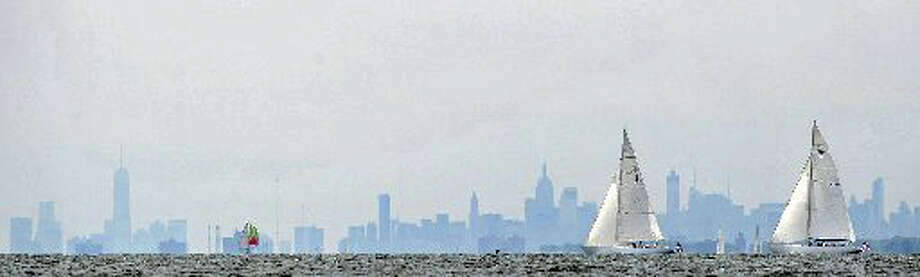 With the Manhattan skyline in the background, sailboats glide on Long Island Sound off Greenwich. Ways are being sought to control pollution entering the Sound and the state's rivers. Photo: File Photo / Greenwich Time File Photo