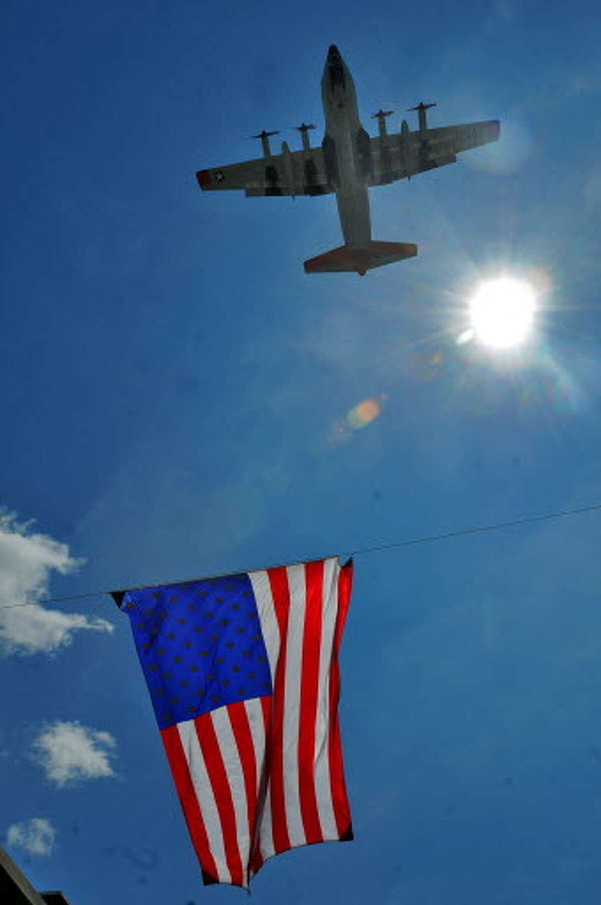 A C-130H from the 109th Airlift Wing from the Stratton Air National Guard Base in Glenville flies over Fourth Street in Troy, NY as part of the annual Flag Day Parade, on Sunday June 14, 2009. (Times Union archive)