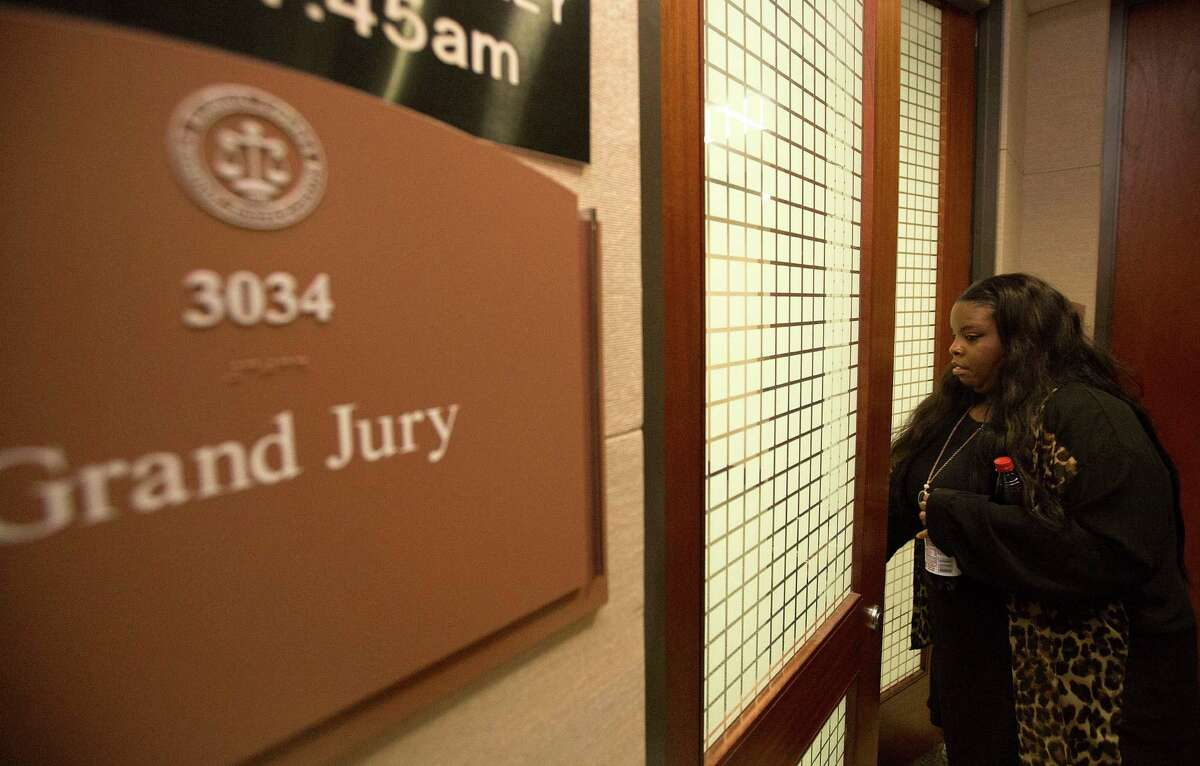 Janet Baker is seen waiting while a Harris County grand jury deliberated the case involving Houston Police Department Officer Juventino Castro, who last year shot Baker's son, Jordan Baker. The grand jury cleared the officer.