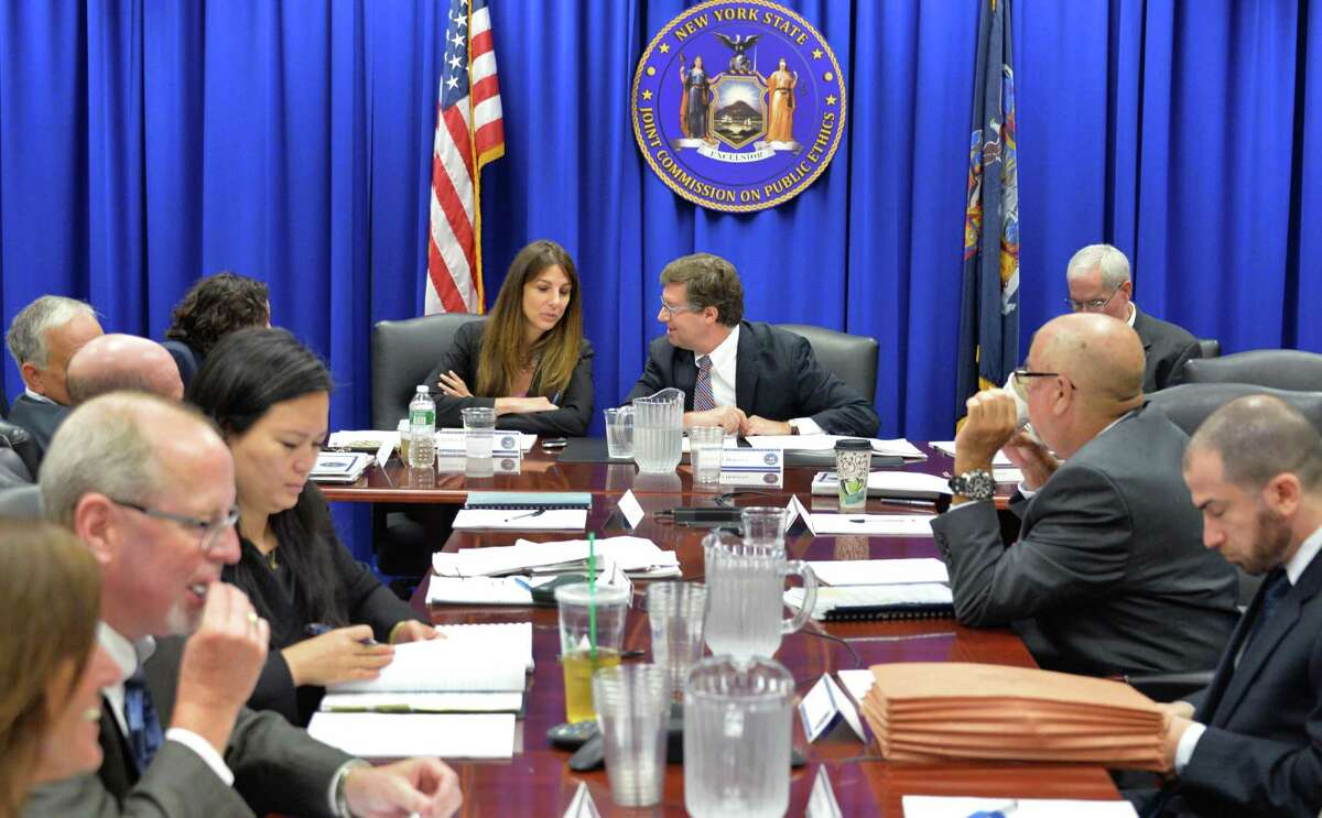 Chairman Daniel J. Horwitz center, confers with Executive Director Letizia Tagliafierro, to his left, during a JCOPE state ethics commission meeting Tuesday August 12, 2014, in Albany, NY. (John Carl D'Annibale / Times Union)