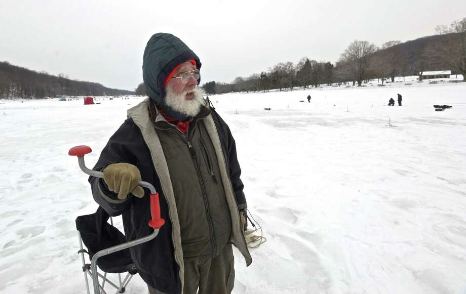 """Pete Warwick, of New Fairfield, drills a hole in the ice as he competes in the annual """" The Jig & Pig"""" ice fishing derby, held this year on Squantz Pond,  Saturday, February 7, 2015, in New Fairfield, Conn. The event, sponsored by The Valley Angler store, of Danbury, has been going on for over 25 years. Photo: H John Voorhees III / The News-Times"""