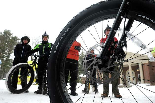 Bikers listen as Shawne Camp co-fonder of the Saratoga Fat Bike Rally talks about the anatomy of a fat bike at Saratoga Spa State Park on Saturday Feb. 7, 2015 in Saratoga Springs , N.Y.  (Michael P. Farrell/Times Union) Photo: Michael P. Farrell / 00030470A