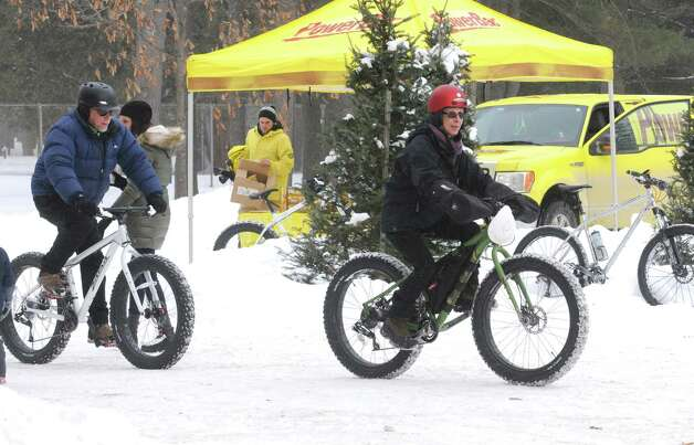 Bruce and JoAnn Gugliotta of Bath, NY celebrate there 4oth wedding anniversary as they take part in the first Saratoga Fat Bike Rally at Saratoga Spa State Park on Saturday Feb. 7, 2015 in Saratoga Springs , N.Y.  (Michael P. Farrell/Times Union) Photo: Michael P. Farrell / 00030470A
