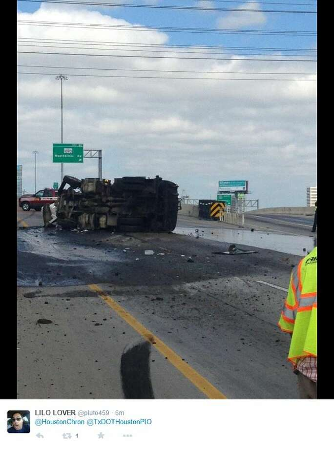 A heavy truck accident closed all of the main lanes on the West Loop, spilling hot tar onto the roadway. Photo: Photos By Newcastle Towing