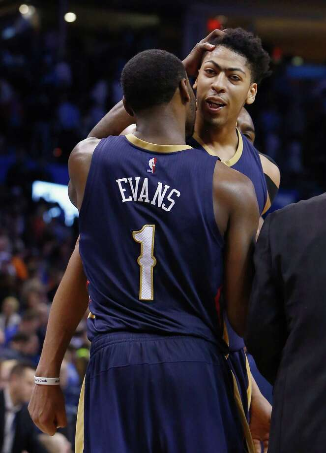 Pelicans forward Anthony Davis gets some love from Tyreke Evans after sinking a game- winning three-pointer Friday against the Thunder. Both teams are fighting for a playoff berth. Photo: Alonzo Adams / Associated Press / FR159426 AP