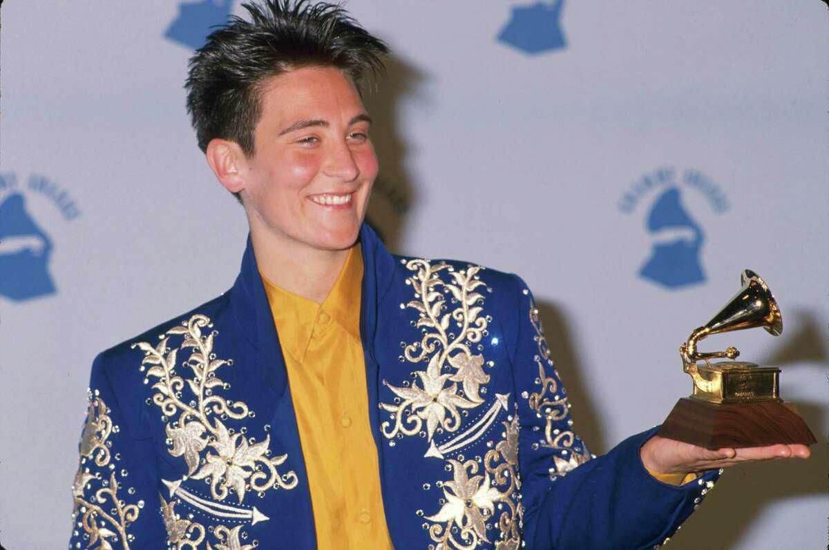 1990: Singer k.d. Lang (holding her award) in Press Room at Grammy Awards.