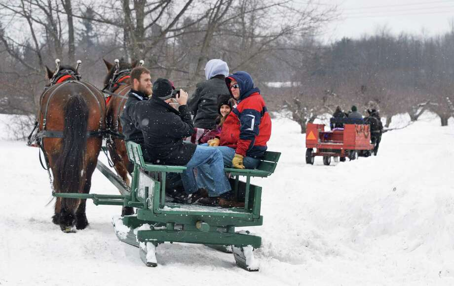 Festival goers are treated to a horse drawn sleigh ride through the orchards at Riverview Orchards as part of the annual Clifton Park WinterFest Saturday Feb. 7, 2015, in Clifton Park, NY.  (John Carl D'Annibale / Times Union) Photo: John Carl D'Annibale / 00030201A