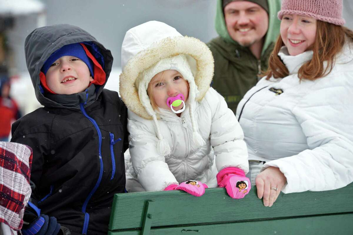 Matthew Vian,left, his sister Alexandra and parents Darren and Meghan Vian of Halfmoon are treated to a horse drawn sleigh ride through the orchards at Riverview Orchards as part of the annual Clifton Park WinterFest Saturday Feb. 7, 2015, in Clifton Park, NY. (John Carl D'Annibale / Times Union)
