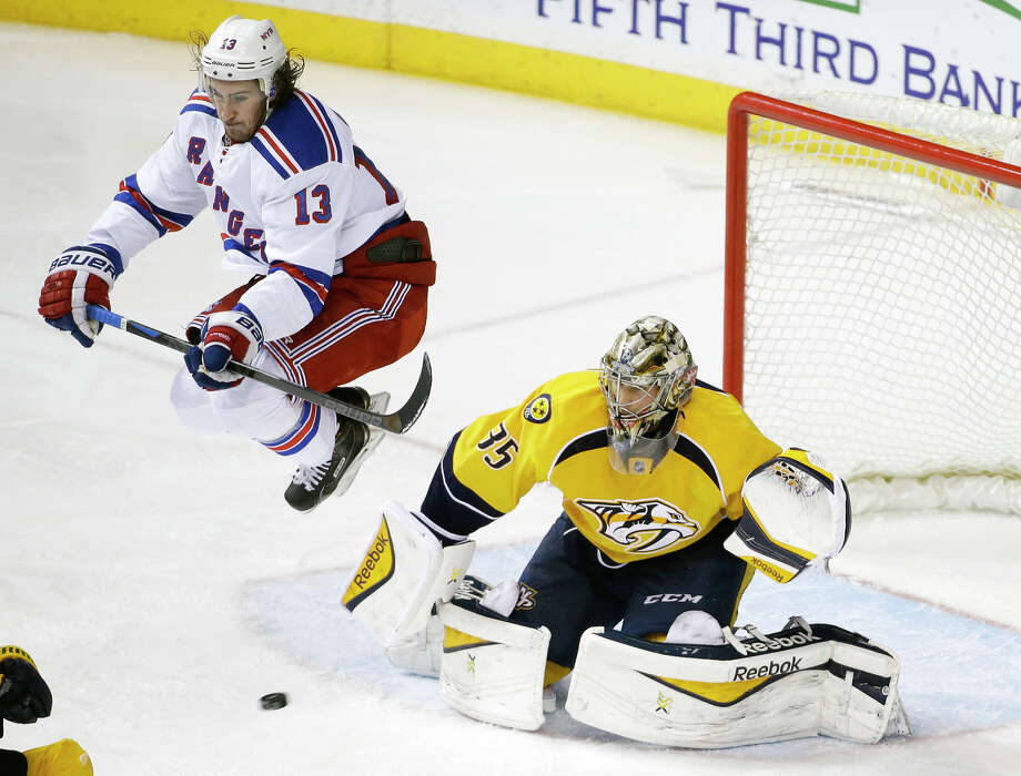 Rangers right wing Kevin Hayes jumps out of the way as Predators goalie Pekka Rinne stops a shot in the second period. Photo: Mark Humphrey / Associated Press / AP