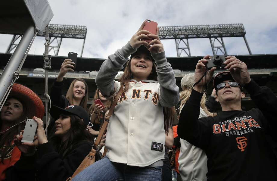 Tatiana Perona, 15, of Benicia is decked out in Giants gear as she takes a snapshot of Pence with her phone. Photo: Michael Macor, The Chronicle