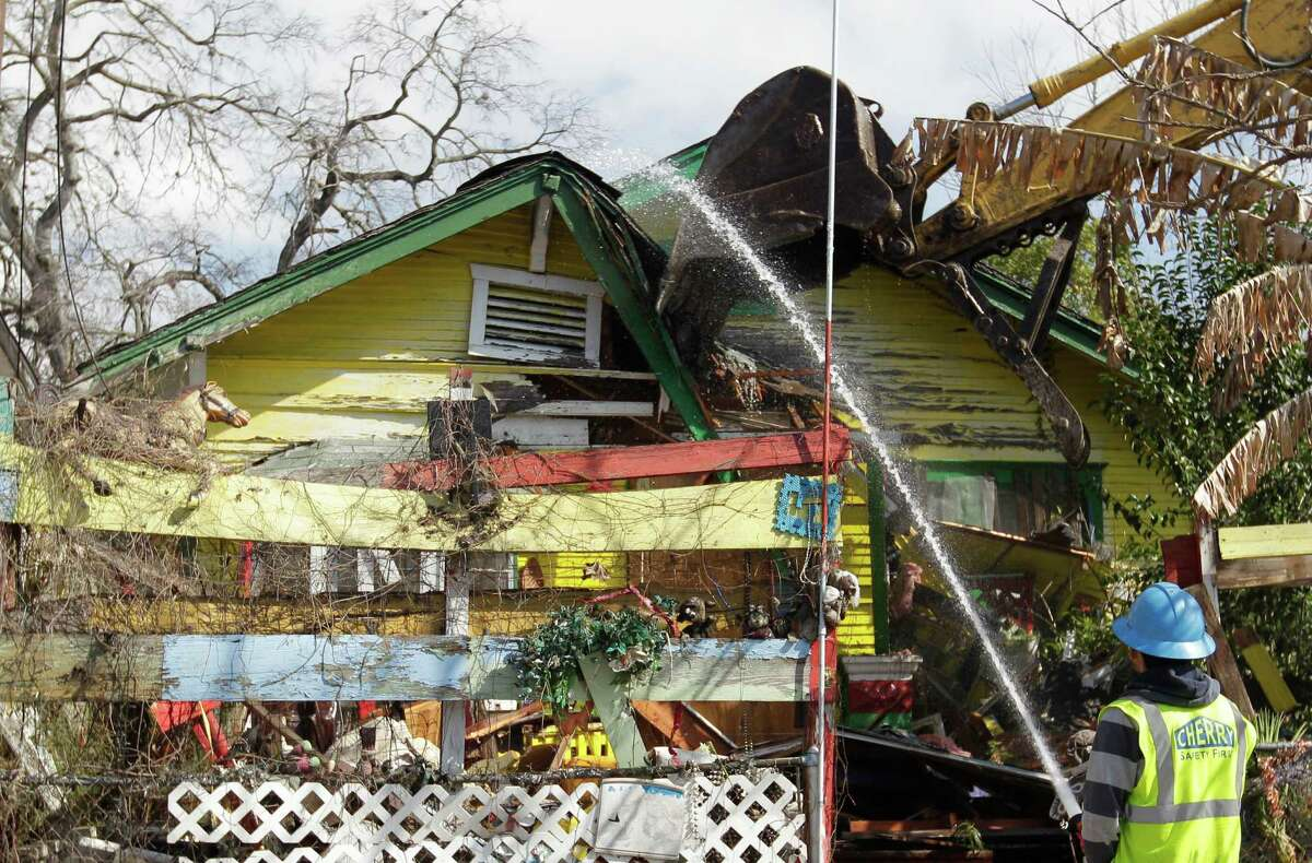 The Cherry Co. crew works on the demolition of the home of Cleveland Turner, the Houston folk artist known as the Flower Man, on Saturday, Feb. 7, 2015, in Houston.