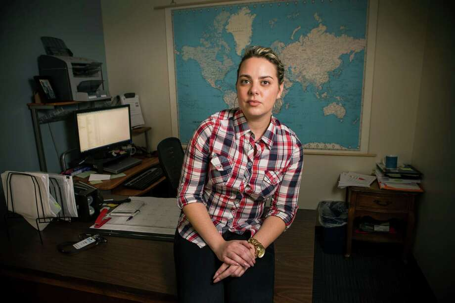 Lena Asensio, 26, is a refugee cash assistance compliance clerk at YMCA International Services in Houston. She crossed into he U.S. at the Mexican border and won asylum. Photo: Brett Coomer, Staff / © 2015 Houston Chronicle