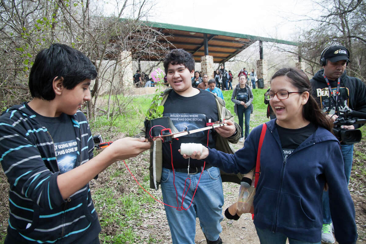 (From left) Timothy Herold, 14, Jose Trevino, 12, and Alexis Manzano, 12, prepare a Delta Flight Frame for the launch of a weather balloon with the Harlandale Middle School Science Corps Saturday Feb. 7, 2015 at Medina River Natural Area.