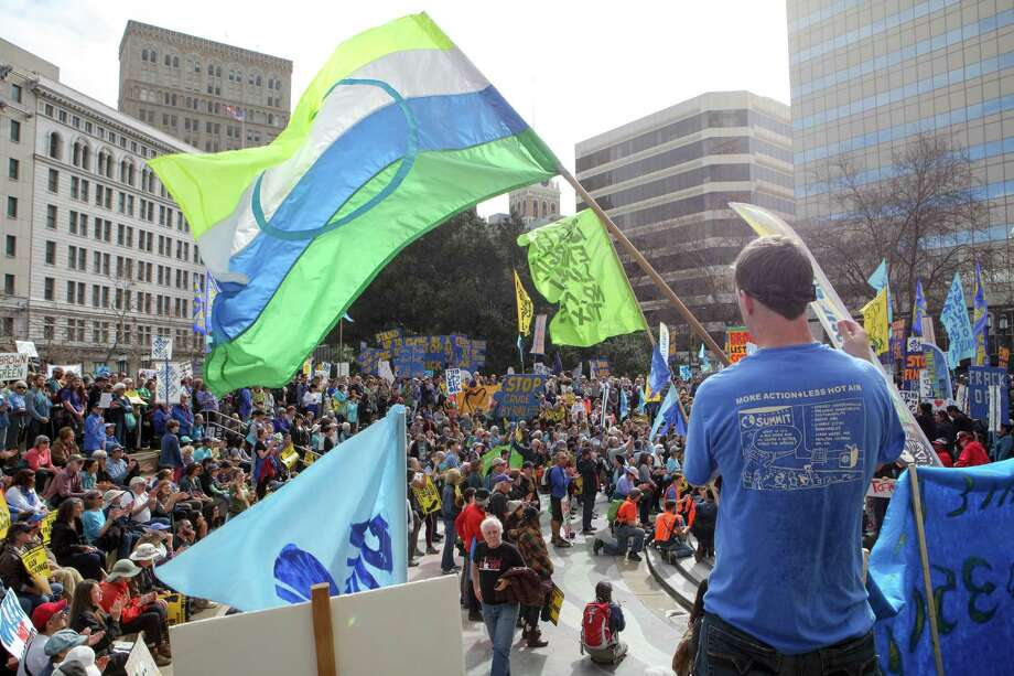 Saturday's march, billed as the country's largest demonstration against hydraulic fracturing, started at Oakland's City Hall and then went through downtown and on to Lake Merritt. Photo: Santiago Mejia / The Chronicle / ONLINE_YES