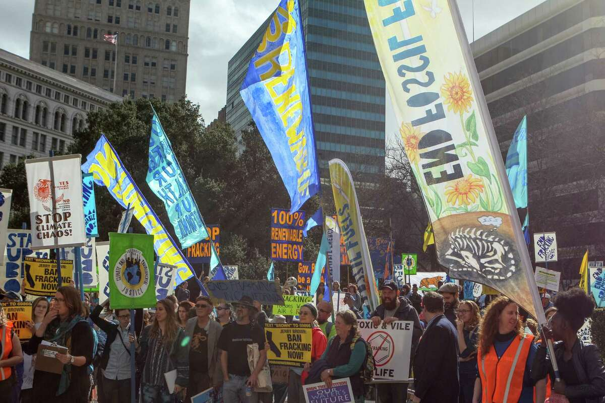 Protesters against fracking rallied at Frank H. Ogawa Plaza and marched for two miles to Lake Merritt Boulevard, Saturday, Feb. 7, 2015, in Oakland.