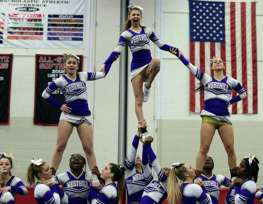 Westhill cheerleaders, from left, Samantha DeMartino, Athena Christon and Lindsey Yorfino compete during the FCIAC Cheer Championships Saturday, Feb. 7, 2015, at Fairfield Warde High School. Photo: Autumn Driscoll / Connecticut Post