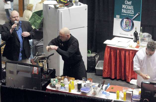 Times Union staff writer Steve Barnes moderates a battle of the chefs during the Times Union Home Expo at the Times Union Center on Saturday Feb. 7, 2015 in Albany , N.Y.  (Michael P. Farrell/Times Union) Photo: Michael P. Farrell / 00030431A