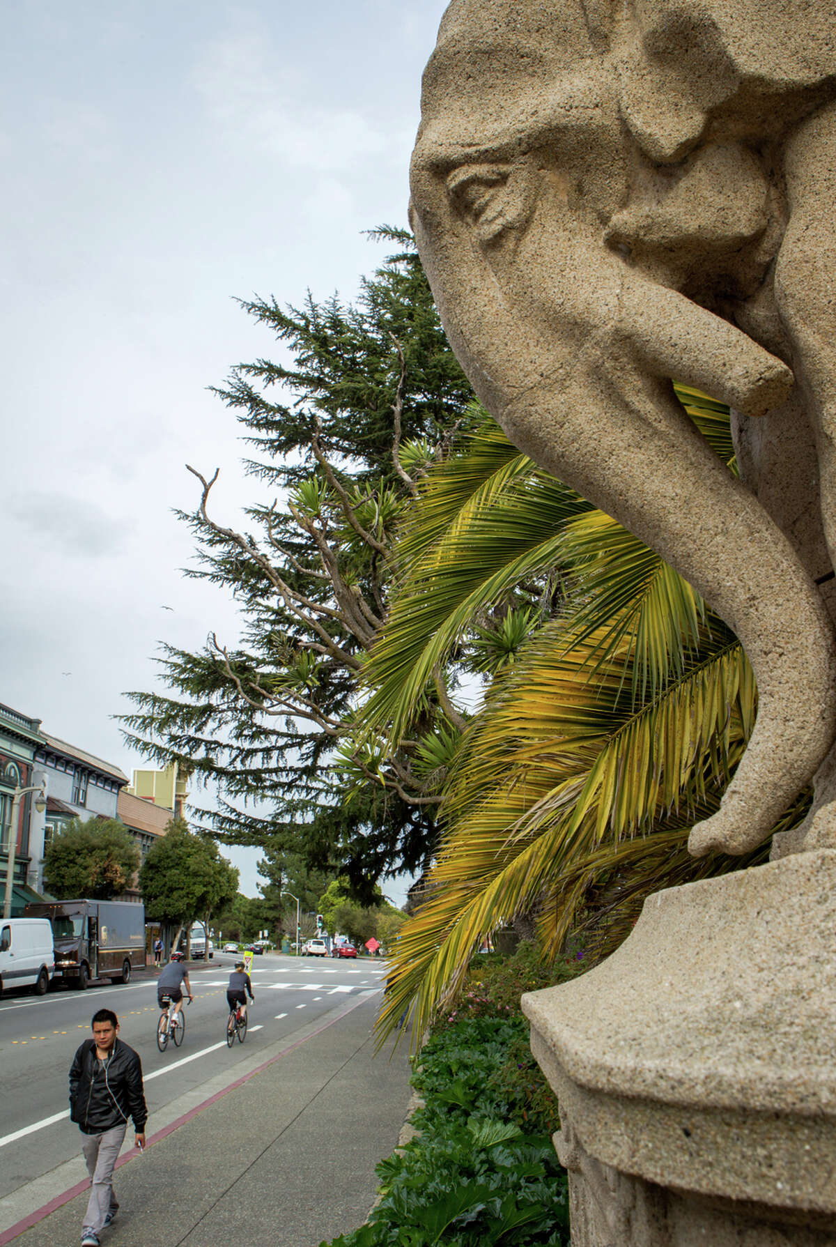 Honorio Perez passes the exposition's elephant light standards, which are now at Viña del Mar park in Sausalito.
