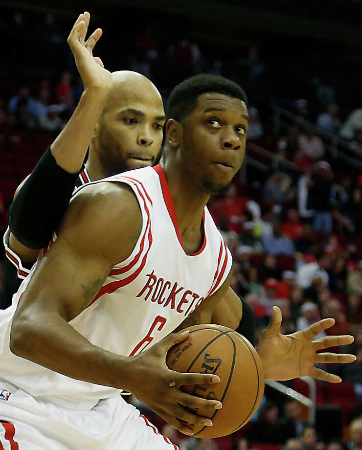 Rockets forward Terrence Jones, right, guarded by Bulls forward Taj Gibson, says he never again will take his time on the basketball court for granted. Photo: James Nielsen, Staff / © 2015  Houston Chronicle