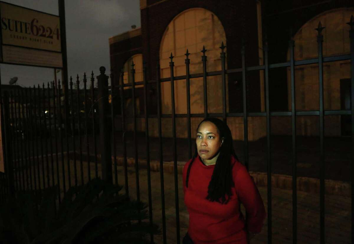 """Pam Fuller, sister of Houston strip club owner Phil Liase, stands outside the abandoned gentleman's club her brother was attempting to open before his murder in 2013. She is confident """"he would have taken over the market"""" had he not been killed."""