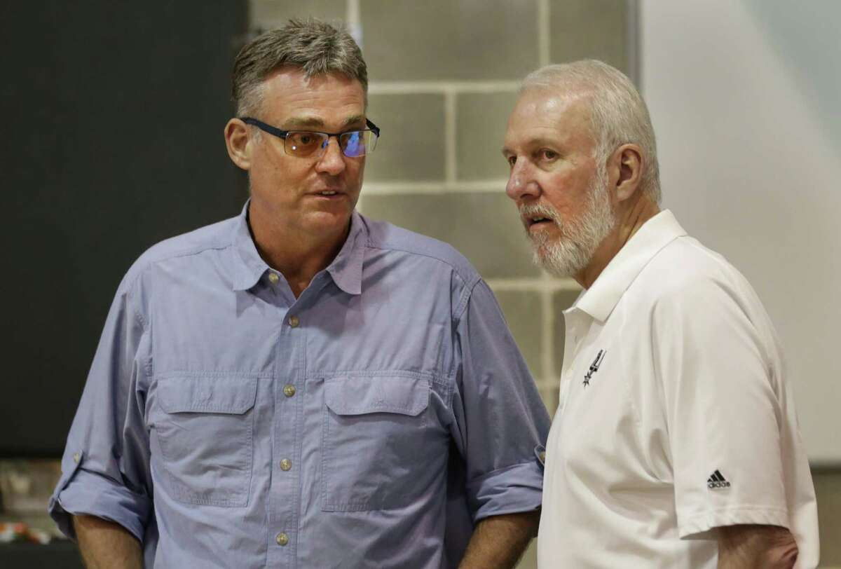 R.C. Buford, left, and Gregg Popovich chat during the San Antonio Spurs media day at their practice facility on Friday, Sept. 26, 2014.