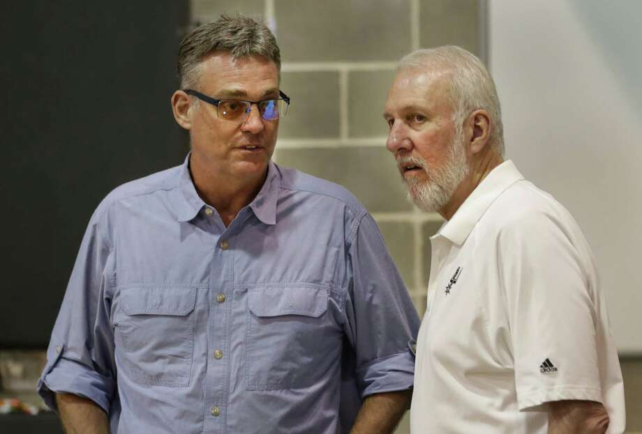 R.C. Buford, left, and Gregg Popovich chat during the San Antonio Spurs media day at their practice facility on Friday, Sept. 26, 2014. Photo: Bob Owen /San Antonio Express-News / ©2013 San Antonio Express-News