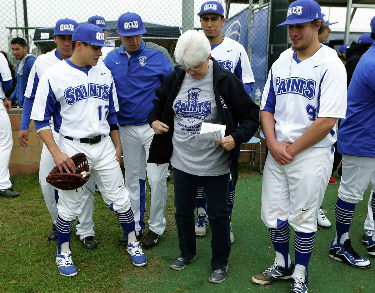 The Our Lady of the Lake University Saints baseball team holds their first ever game at Missions Baseball Academy. Sister Jane Ann Slater, President of OLLU, shows off her t-shirt. The Saints lost the inaugural game to University of Houston-Victoria 5-3 on Feb. 6, 2015.